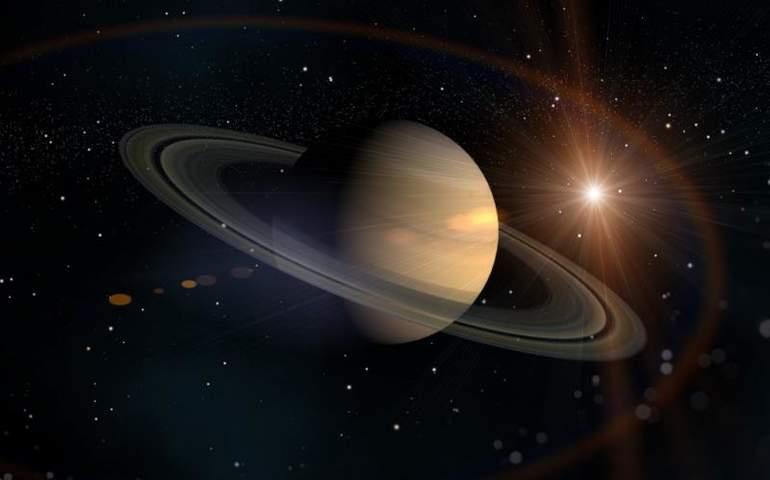 Satürn, yıldızlar ve güneş