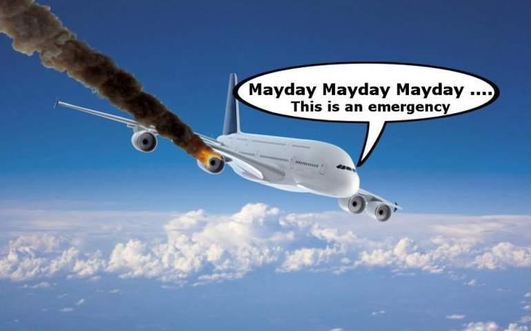 Uçak ve MAYDAY yazan konuşma bulutu.